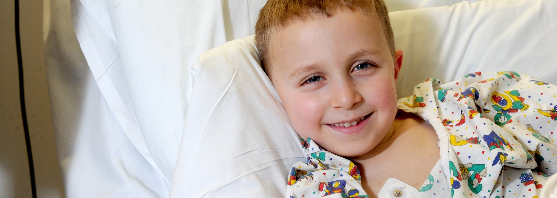 Young patient smiling whilst in hospital